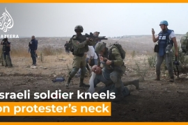 Video shows Israeli soldier kneeling on protester's neck [Daylife]