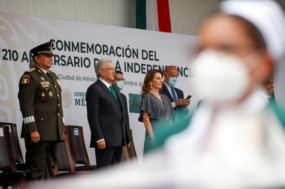 President Andres Manuel Lopez Obrador, his wife Beatriz Gutierrez Muller and Secretary of Defense Luis Sandoval attend the military parade to celebrate Independence Day. [Carlos Jasso/Reuters]
