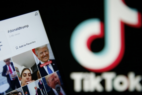 US President Donald Trump is trying to ban the Chinese-owned TikTok app in the US [Hollie Adams/Bloomberg]