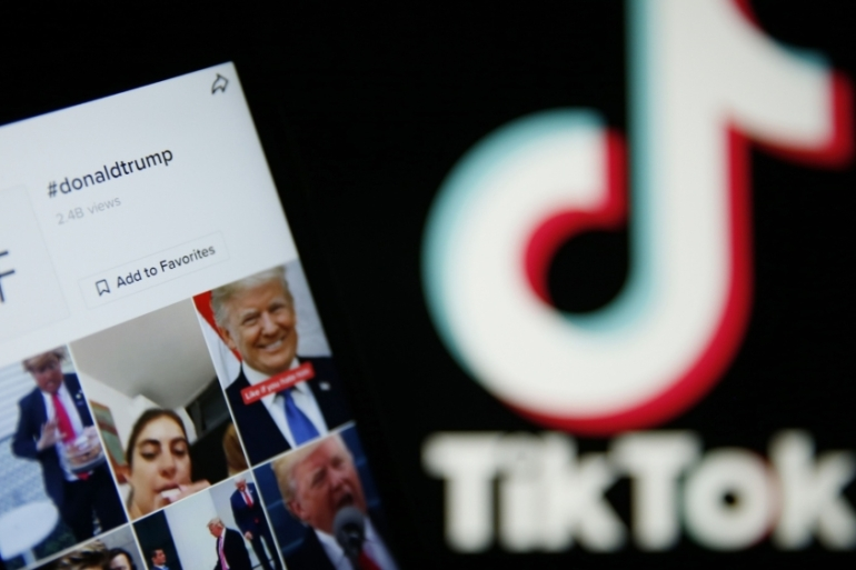 United States President Donald Trump is pushing for a deal by September 15 for China's ByteDance to sell TikTok, its US-based video-sharing app, on national security grounds [File: Hollie Adams/Bloomberg]