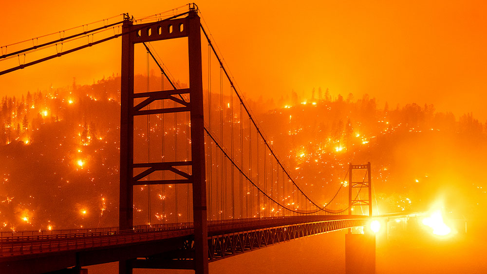 Across California five of the state's six biggest wildfires in history were still burning at the end of September