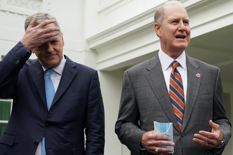 American Airlines CEO Doug Parker wipes his brow as he and Southwest Airlines CEO Gary Kelly speak to reporters after meeting with White House Chief of Staff Mark Meadows in Washington, DC, United States [File: Kevin Lamarque/Reuters]