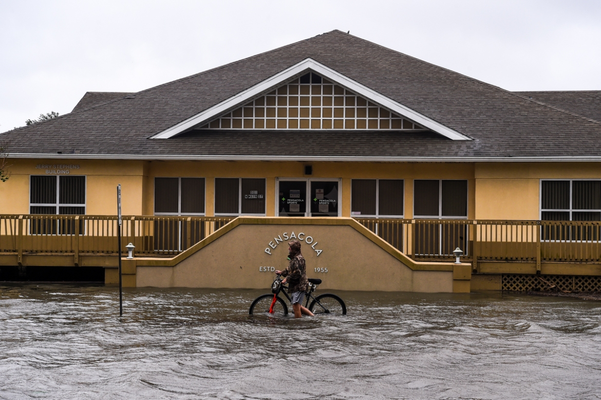 Hurricane Sally barrelled into the US Gulf Coast early on Wednesday, with forecasts of drenching rains that could provoke 'historic' and potentially deadly flash floods. [Chandan Khanna/AFP]