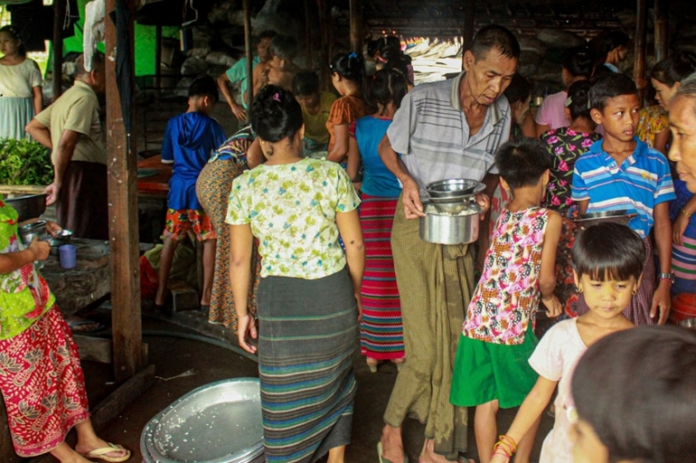 Internally displaced persons (IDPs) cook at a camp in Rakhine State last week. With social distancing nearly impossible, IDPs are at risk of contracting the coronavirus [Supplied/Al Jazeera]