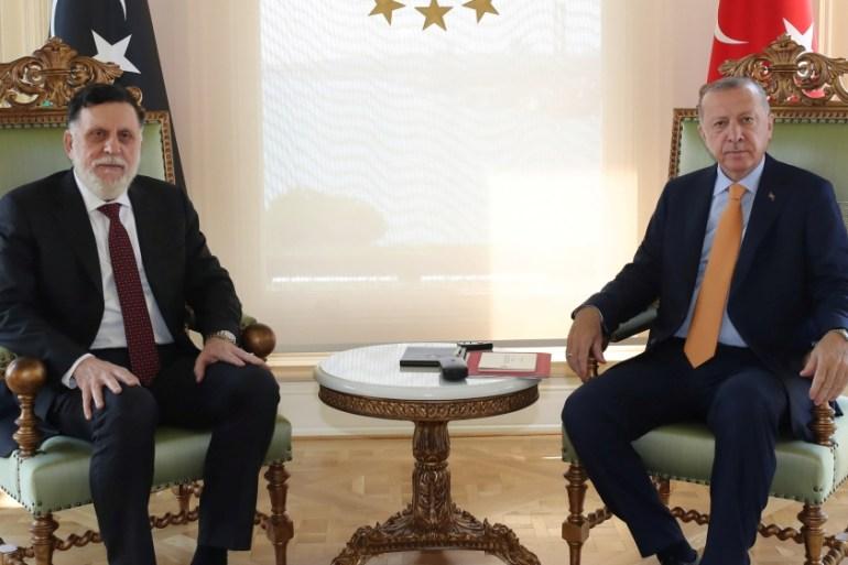 Erdogan, right, met al-Sarraj in Istanbul on September 6 [Murat Cetinmuhurdar/PPO/Handout via Reuters]