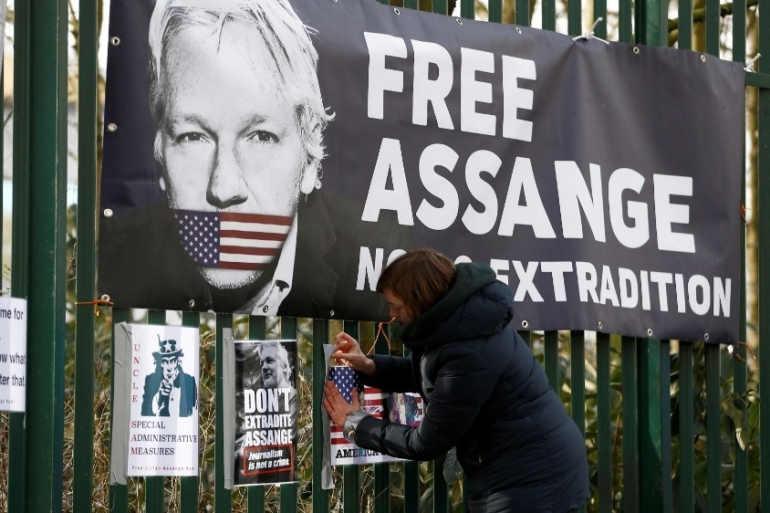 Assange is fighting extradition from the UK to the US over the release of confidential cables by WikiLeaks [File: Henry Nicholls/Reuters]