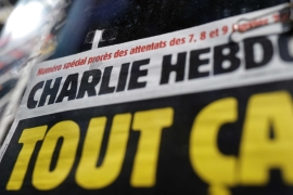 The French satirical magazine Charlie Hebdo is seen at a newspapers kiosk in Paris on the opening day of the trial of the January 2015 Paris attacks on September 2, 2020 [Reuters/Christian Hartmann]