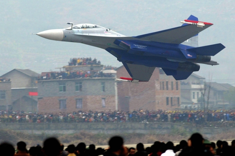 Russian-made Chinese jet fighters Su-30 were reportedly among the aircraft that flew over Taiwan's southwest on Thursday [File: Liu Jin/AFP]