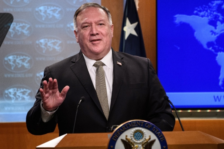 US Secretary of State Mike Pompeo cast the move as a response to what he said was Beijing's restrictions on American diplomats based in China [Nicholas Kamm/Pool via Reuters]