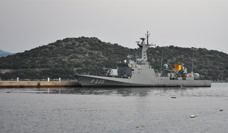 A Turkish warship in docks in Kas Marina as geopolitical tensions rise in the Eastern Mediterranean [Sami Kent/Al Jazeera]