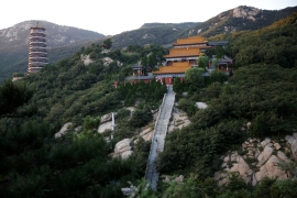 Taoist temple Jiuyang Palace and Jiuyang Pagoda stand in Laiwu, Shandong province, China. The monastery complex, where a small community of priests lives, sleeps, eats and worships, is spread across a rocky hill. [Tingshu Wang/Reuters]