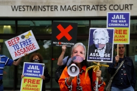 People demonstrate outside Westminster Magistrates Court in London on August 14, 2020 [File: Kirsty Wigglesworth/AP]