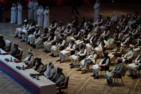 Delegates attend talks between the Afghan government and the Taliban in Doha [Sorin Furcoi/Al Jazeera]