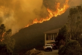 Wildfires rage in Salinas, California on August 17, 2020 [File: AP/Noah Berger]