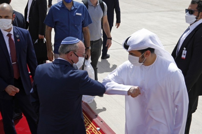 Israeli National Security Adviser Meir Ben-Shabbat elbow bumps with an Emirati official, as he leaves Abu Dhabi on September 1, 2020 [Nir Elias/Pool via AP]