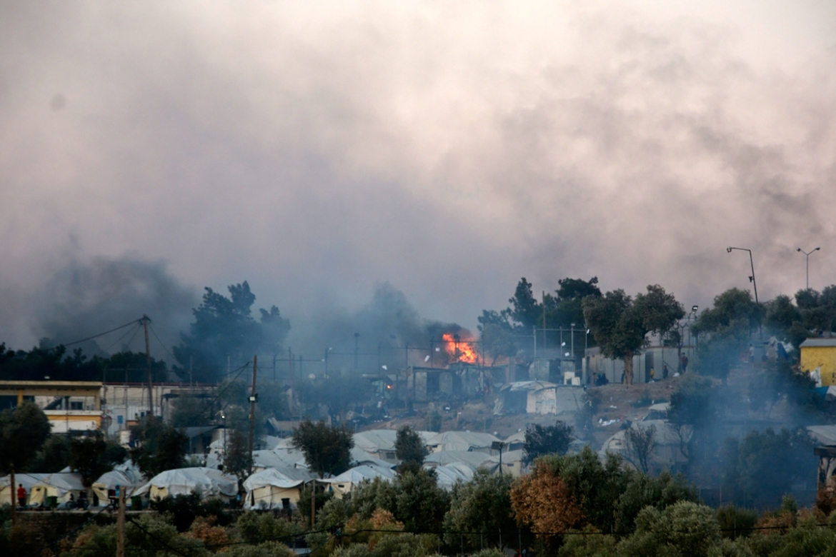 Multiple fires gutted much of the site on the Greek island. [Panagiotis Balaskas/AP Photo]