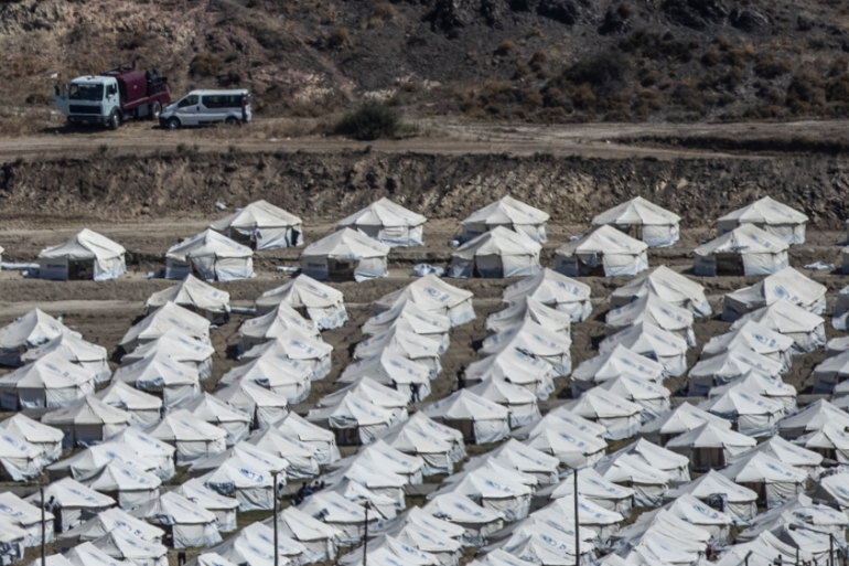 A general view of the temporary camp for refugees and migrants near Mytilene town, on the northeastern island of Lesbos, Greece [Petros Giannakouris/The Associated Press]