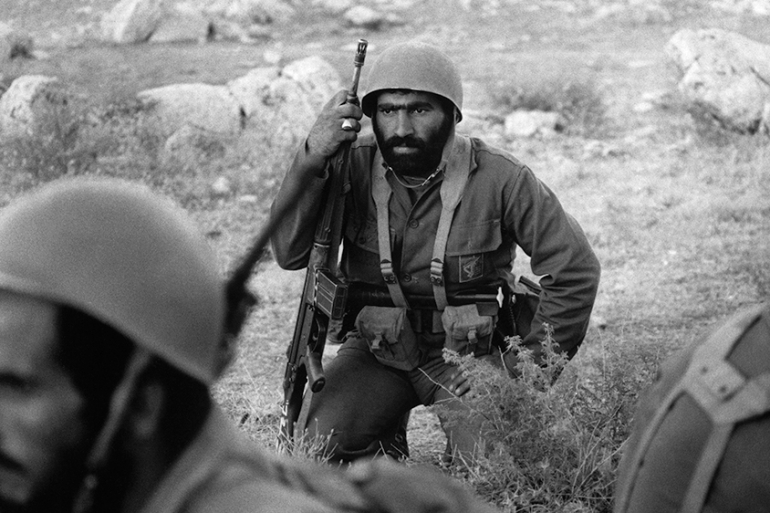 An Iranian soldier rests while holding his G3 assault rifle on the Iran-Iraq front near Qasr-e Shirin on October 13, 1980 [Kaveh Kazemi/Getty Images]
