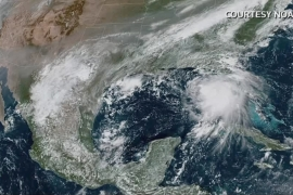 Sally was upgraded to a hurricane on Monday, the US National Hurricane Center (NHC) said, but its trajectory has shifted east towards Mississippi, likely sparing some of Louisiana's oil refining operations [Courtesy NOAA/via Reuters]