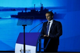 Mitsotakis said Greece would acquire 18 French-made Rafale warplanes, four multi-purpose frigates, while also recruiting 15,000 new troops [Alexandros Avramidis/Reuters]