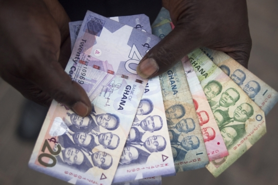 The cedi has slumped 18.8 percent a year on average over the past 25 years [File: Ty Wright/Bloomberg]
