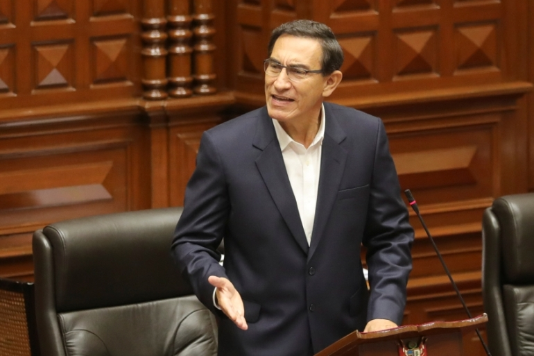 Martin Vizcarra addresses Congress as legislators gathered to vote over whether to remove the president over allegations of 'moral incapacity' [Peruvian Presidency/Handout via Reuters]