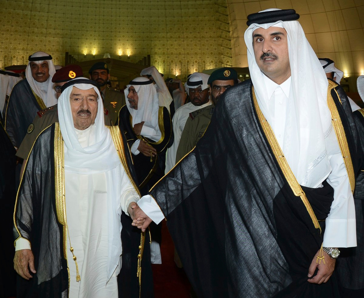 Kuwait's Emir Sheikh Sabah al-Ahmad al-Jaber al-Sabah, left, with Qatar's Sheikh Tamim bin Hamad Al Thani in Doha. Kuwait has acted as a mediator in the GCC conflict after Saudi Arabia, Bahrain, the UAE and Egypt cut ties with Qatar in June 2017. [KUNA via AP]
