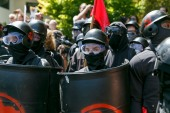 Counterdemonstrators prepare to face off against far right Patriot Prayer protesters during a rally in Portland, Oregon in 2018 [John Rudoff/AP Photo]