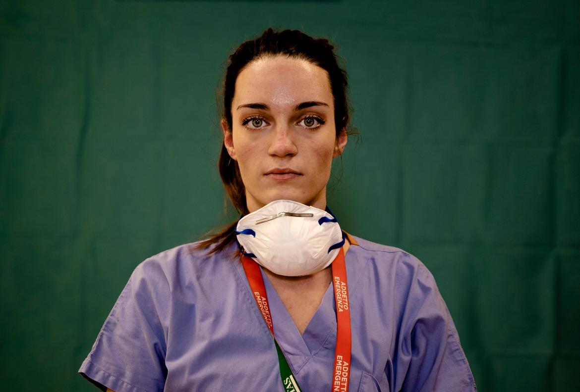 Martina Papponetti, 25, a nurse at the Humanitas Gavazzeni Hospital in Bergamo, at the end of her shift on Friday, March 27, 2020. [Antonio Calanni/AP Photo]