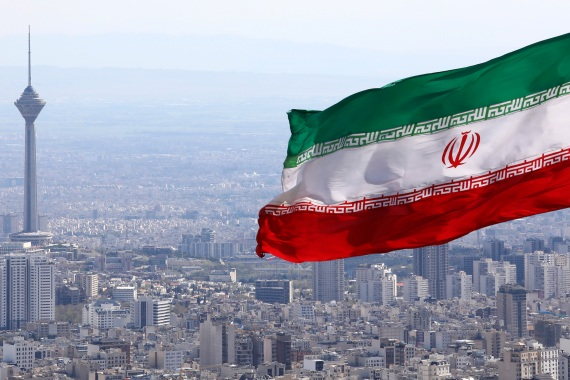 Iran's national flag waves as Milad telecommunications tower in Tehran [File: Vahid Salemi/AP Photo]