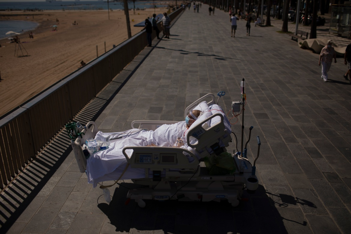 Francisco Espana, 60, looks at the Mediterranean Sea from a promenade next to the Hospital del Mar in Barcelona, Spain, on Friday, September 4, 2020. Francisco spent 52 days in the Intensive Care Unit due to coronavirus, but today he was allowed by his doctors to spend almost 10 minutes at the seaside as part of his recovery therapy. [Emilio Morenatti/AP Photo]