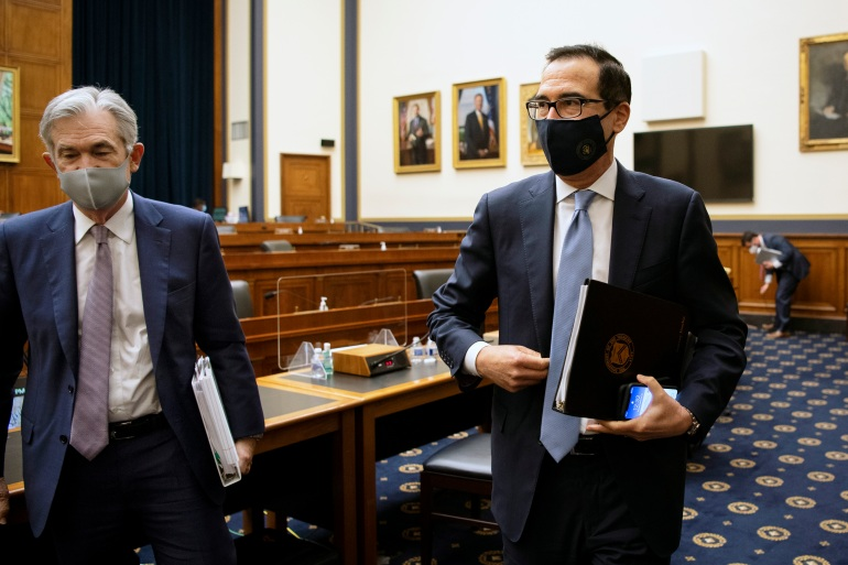 Ketua Federal Reserve Jerome Powell, kiri, dan Menteri Keuangan Amerika Serikat Steve Mnuchin, kanan, keduanya memberikan kesaksian pada hari Selasa di hadapan Komite Jasa Keuangan DPR AS [Caroline Brehman / The Associated Press]