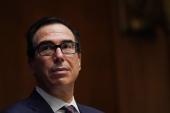 'If the Democrats are willing to sit down, I'm willing to sit down anytime for bipartisan legislation, let's pass something quickly', Treasury Secretary Steve Mnuchin told a Senate banking committee hearing on Thursday [File: Toni L Sandys/The Washington Post via AP]