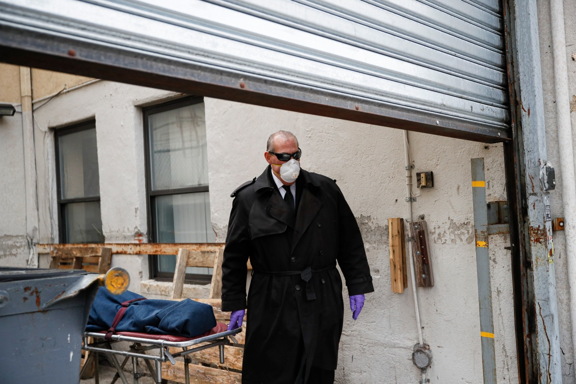 Funeral director Tom Cheeseman collects a body from a nursing home, on Friday, April 3, 2020, in the Brooklyn borough of New York. 'We took a sworn oath to protect the dead, this is what we do,' he said. 'We're the last responders. Our job is just as important as the first responders.' [John Minchillo/AP Photo]