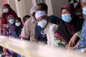 Voters wearing face masks to help curb the spread of the coronavirus wait for their turn at a polling station during a state election on the outskirts of Kota Kinabalu, in Malaysia's Sabah state on Borneo island [AP]