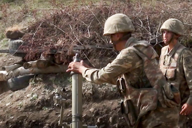Fighting between Armenian and Azerbaijani forces over the disputed region of Nagorno-Karabakh continued on Monday morning after erupting the day before [Azerbaijan's Defense Ministry/AP]