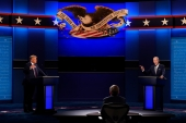 President Donald Trump and Democratic presidential candidate former Vice President Joe Biden, are seen during the first presidential debate on September 29, 2020, at Case Western University and Cleveland Clinic, in Cleveland, Ohio [AP Photo/Patrick Semansky]