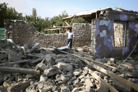 Fighting between Azerbaijan and Armenia entered a fourth day in the biggest eruption of the conflict in decades [Aziz Karimov/AP]