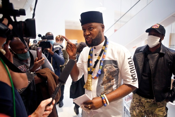 Congolese activist Mwazulu Diyabanza talks to the media at the Palais de Justice courthouse, in Paris, September 30, 2020 [Thibault Camus/AP)