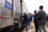 Democratic presidential candidate former Vice President Joe Biden boards a train at Amtrak's Cleveland Lakefront train station [Andrew Harnik/The Associated Press]