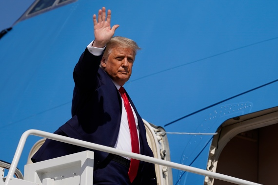 President Donald Trump waves while boarding Air Force One [Alex Brandon/The Associated Press]