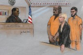 In this June 19, 2015, file courtroom sketch, David Wright, second from left, is depicted standing before Magistrate Judge Donald Cabell, left, with attorney Jessica Hedges, second from right, and Nicholas Rovinski, right, during a hearing in federal court in Boston [File: Jane Flavell Collins via AP Photo]