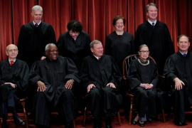 FILE PHOTO: US Supreme Court justices pose for a group portrait at the Supreme Court in Washington, DC, November 30, 2018. Seated left to right: Associate Justice Stephen Breyer, Associate Justice Clarence Thomas, Chief Justice of the United States John G Roberts, Associate Justice Ruth Bader Ginsburg and Associate Justice Samuel Alito, Jr. Standing, left to right: Associate Justice Neil Gorsuch, Associate Justice Sonia Sotomayor, Associate Justice Elena Kagan and Associate Justice Brett M. Kavanaugh REUTERS/Jim Young/File Photo
