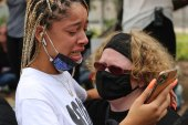 Protesters cry after learning there will be no murder charges in the case [Chris Kenning_Al Jazeera]