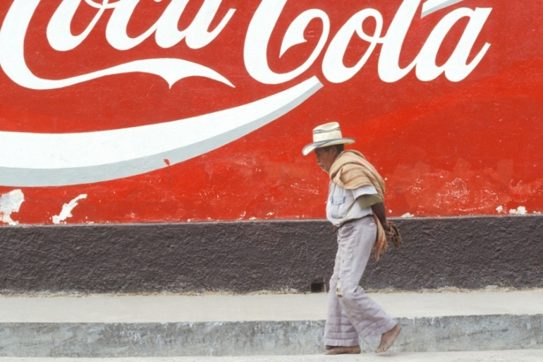 In much of Mexico it sometimes seems impossible to take a step without tripping over Coca-Cola advertisements or similar propaganda, writes Fernandez [Riccardo Lombardo/Getty Images]