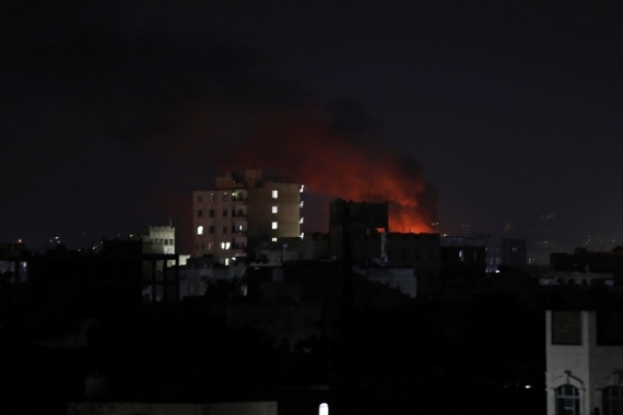 Fire is seen at one of the sites of Sunday's Saudi-led air raids in Sanaa [Khaled Abdullah/Reuters]