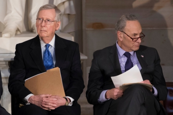 Soon-to-be Senate Minority Leader Mitch McConnell, left, and Majority Leader Chuck Schumer, right, are working on a power-sharing agreement for the new 50-50 Senate [File: J Scott Applewhite/AP Photo]