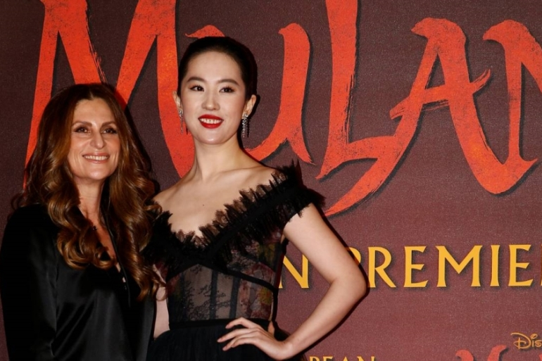 New Zealand's Niki Caro directs the $200m Mulan film starring Yifei Liu, who also faces criticism for her support of the Hong Kong police amid allegations of excessive violence against pro-democracy protesters [Henry Nicholls/Reuters]