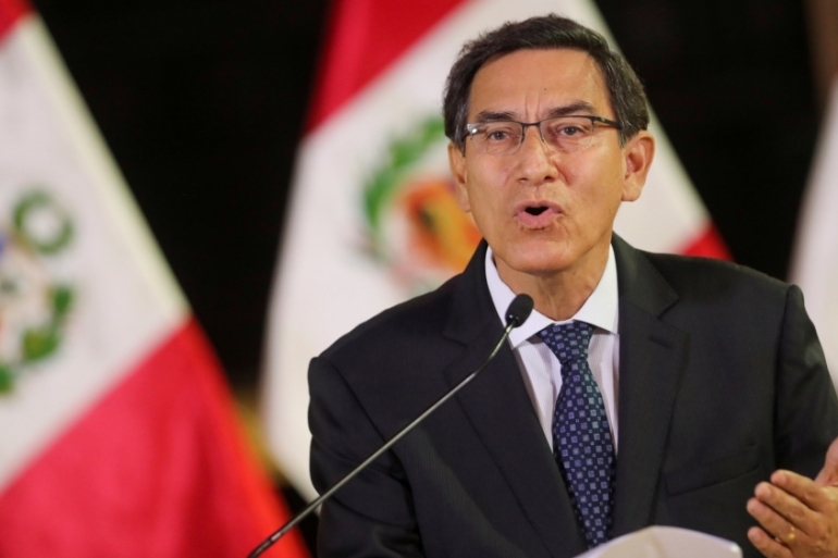 Martin Vizcarra is under fire over alleged ties to a little-known singer involved in a fraud case [File: Peruvian Presidency/Handout via Reuters]