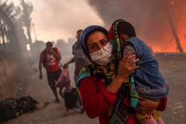Who should look after refugees displaced by Greece camp fire?